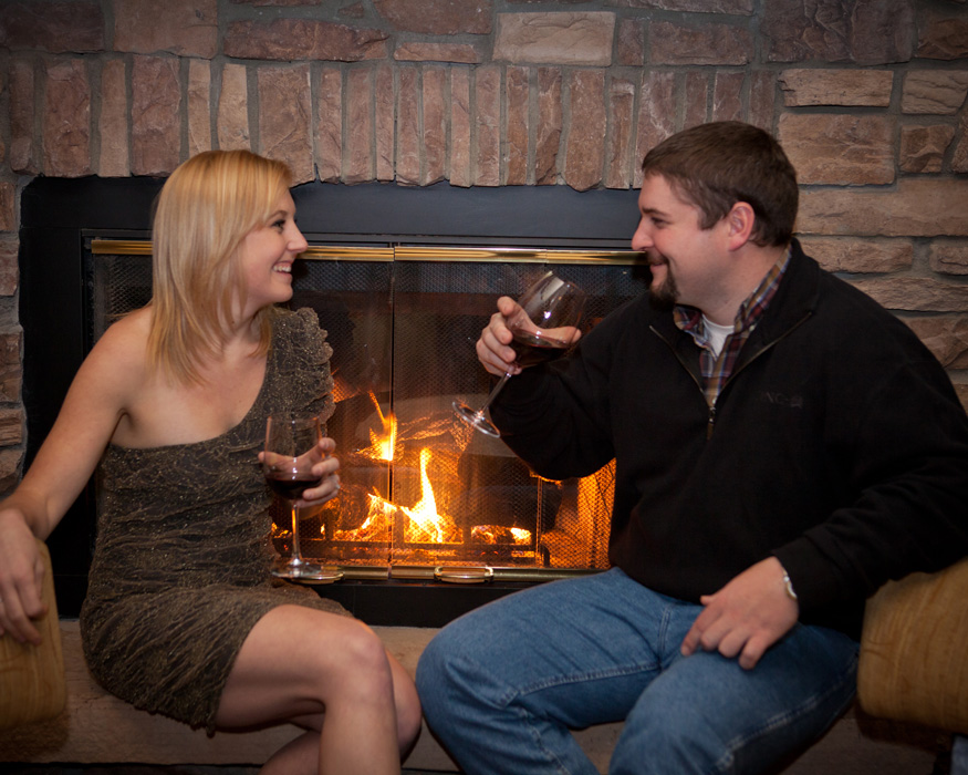 wine tasting couple fireplace portrait engagement