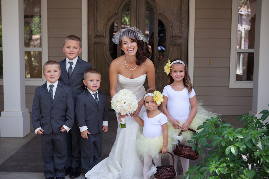 ring bearers and flower girls with bride