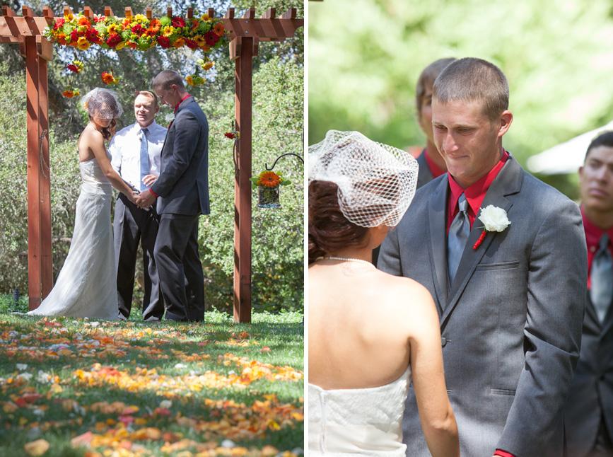 bride and groom under arch wedding day