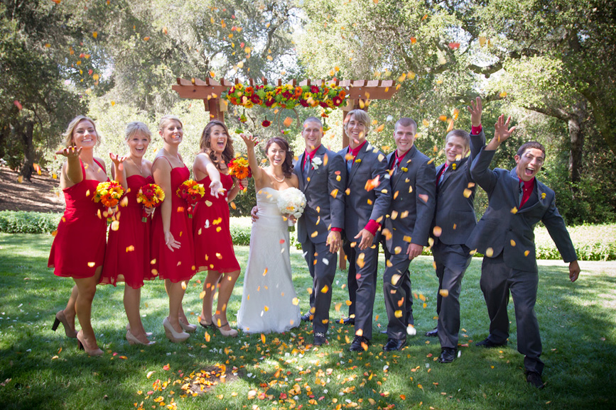 wedding party fun picture pose throwing rose petals