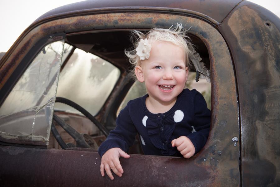 little girl in old truck